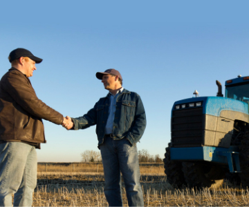Banker Shaking Hands with Farmer